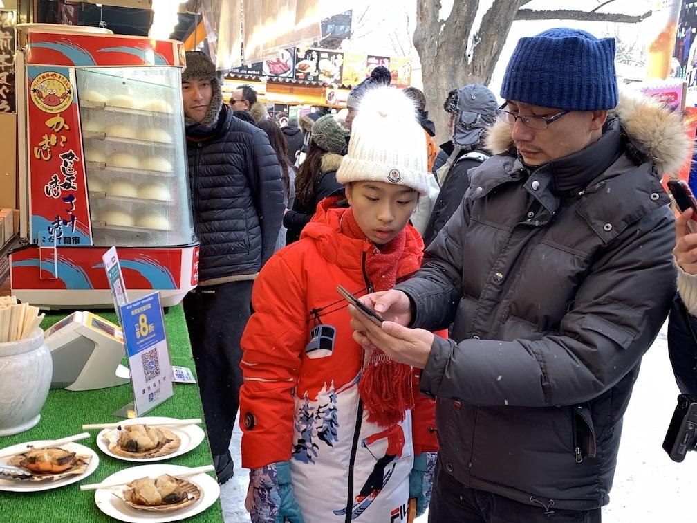 中国人に大人気のさっぽろ雪まつりへALIPAY決済を導入、北海道グルメから雪のアクティビティまでキャッシュレスで楽しむ